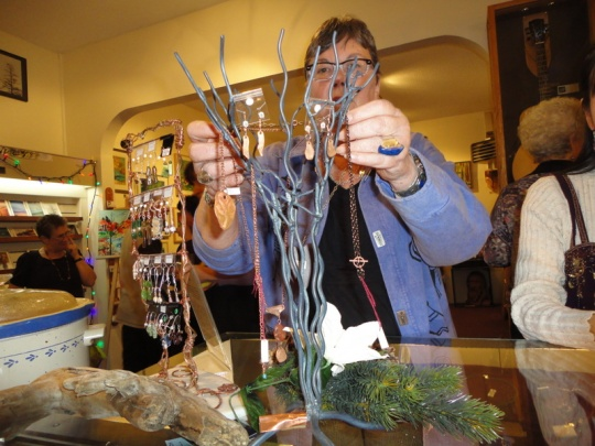 There was lots of new art displayed. Here is Karin adding new jewelry.